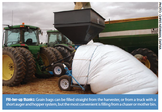 Fill-her-up thanks: Grain bags can be filled straight from the harvester, or from a truck with a short auger and hopper system, but the most convenient is filling from a chaser or mother bin.
