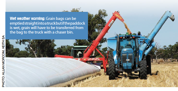 Wet weather warning: Grain bags can be emptied straight into a truck but if the paddock is wet, grain will have to be transferred from the bag to the truck with a chaser bin.
